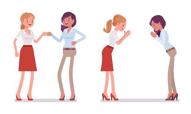 Frauen in fauststoß und namaste-geste