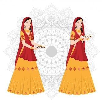 Frauen in traditioneller indischer kleidung auf mandala.