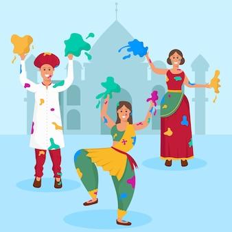 Frauen in traditioneller kleidung feiern holi festival