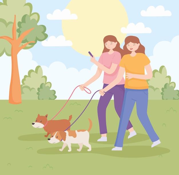 Frauen mit hunden spazieren