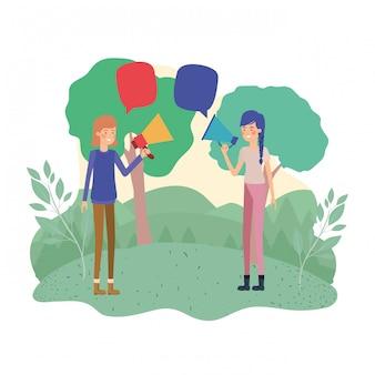 Frauen mit megaphon in der hand in der landschaft