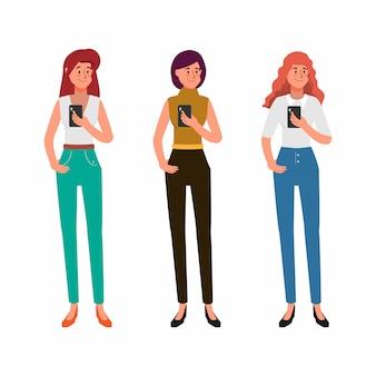 Frauen nutzen das mobiltelefon für die kommunikation in sozialen netzwerken.