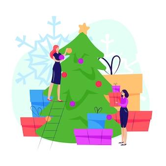 Frauen schmücken weihnachtsbaum