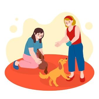 Frauen spielen mit ihren hunden