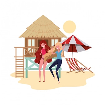 Frauen stehen am strand mit strandhaus