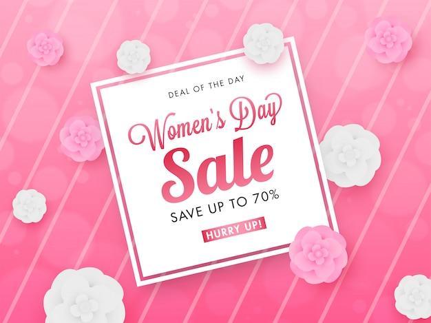 Frauen-tagesverkaufs-plakat-entwurf mit 70% rabattangebot und blumen verziert auf rosa gestreiftem hintergrund.