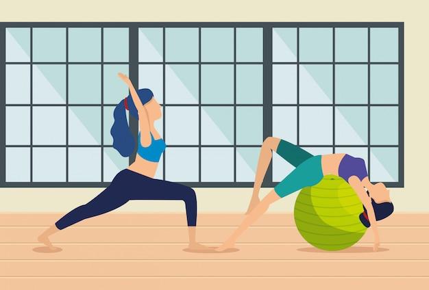 Frauen üben yoga-übungen im haus