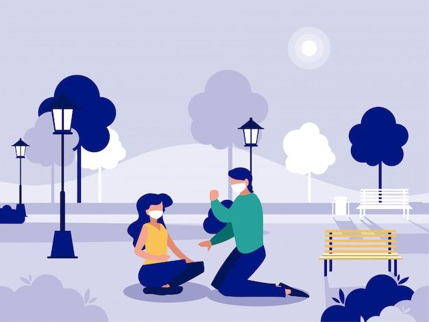 Frauen- und mannpaar mit masken am park