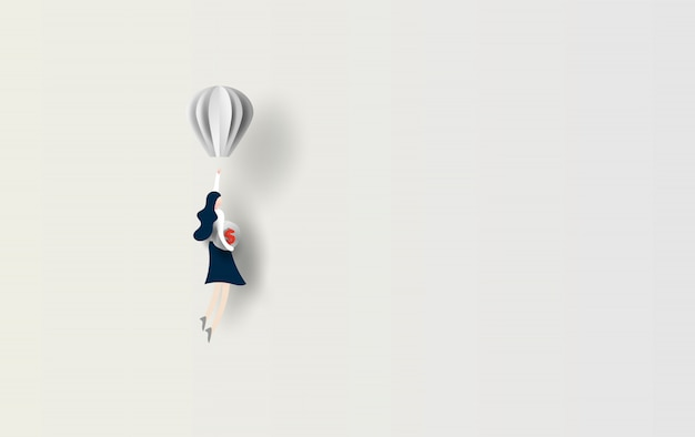 Frauenfliegen mit ballon halten sie dollarmünze.