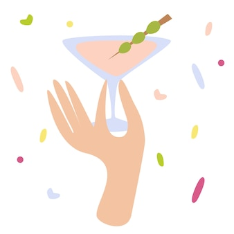 Frauenhand, die ein cocktailglas mit martini oder alkoholgetränk mit oliven hält happy hour
