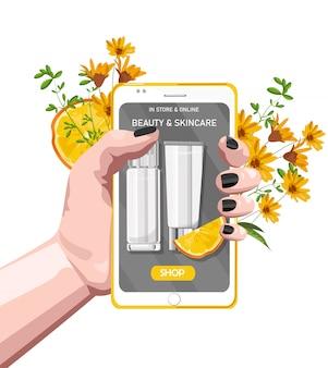 Frauenhand, die intelligentes telefon mit biokosmetikproduktstandort hält