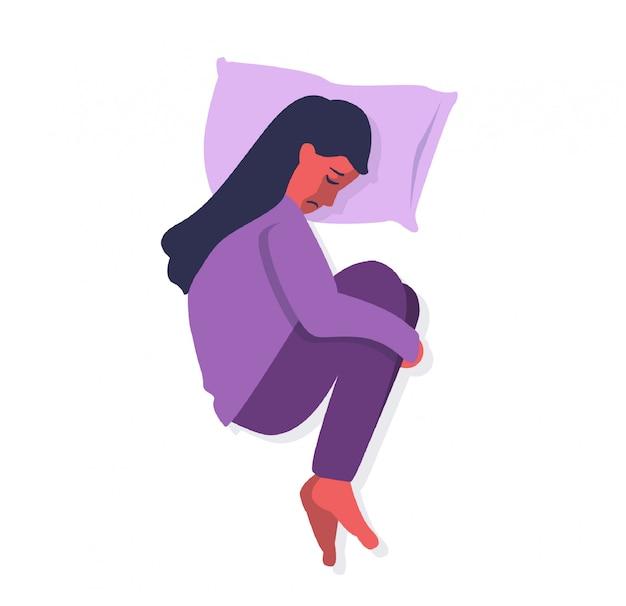 Frauenknie der depressionsstörung, die auf dem bett umarmt