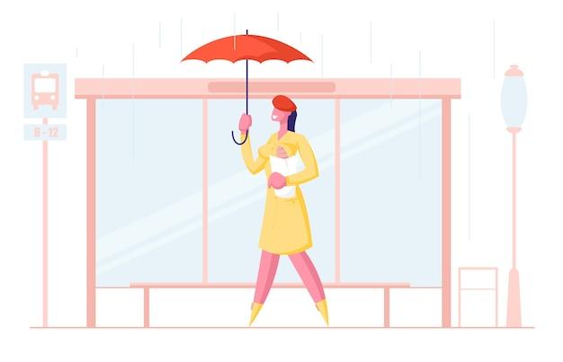 Frauenstadtbewohner, der regenschirm und brotstand auf bushaltestelle hält