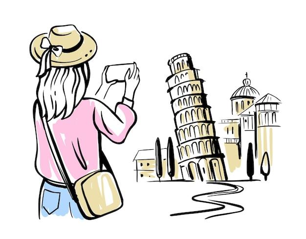 Frauentourist macht foto auf smartphone des turms von pisa.