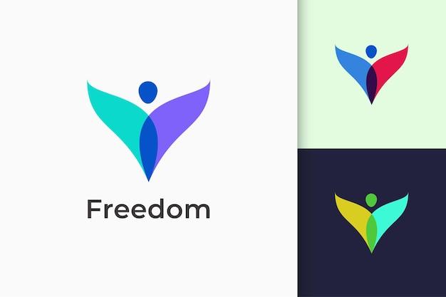 Freiheit oder menschliches logo steht für erfolg und glücklich für yoga oder wohltätigkeit