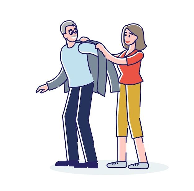 Freiwillige frau, die älteren grauhaarigen mann hilft, sich anzuziehen