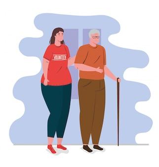 Freiwillige frau, die rotes hemd mit altem mann, wohltätigkeits- und sozialfürsorge-spendenkonzept verwendet