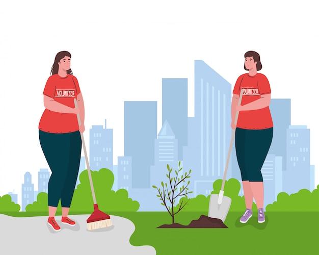 Freiwillige frauen mit pinsel und schaufel pflanzen