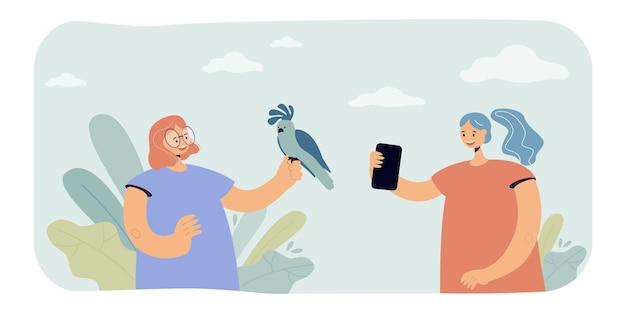 Freunde, die mit papagei fotografieren. flache abbildung