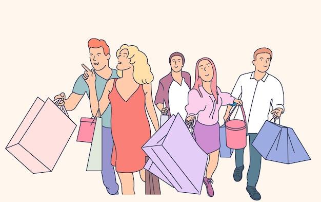 Freunde gehen zusammen mit einkaufstüten