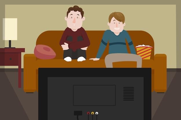 Freunde schauen sich einen film an und essen popcorn