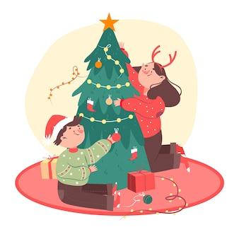 Freunde schmücken weihnachtsbaum