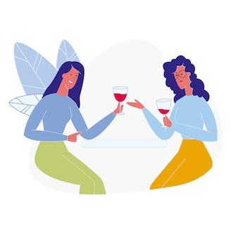 Freundinnen, die flach rotwein trinken