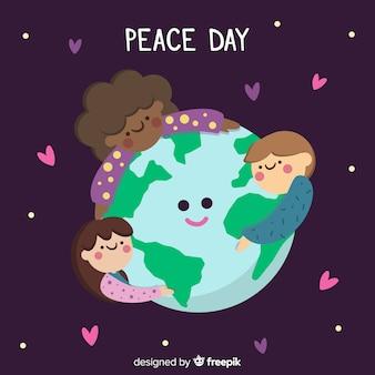 Friedenstageshintergrund mit den kinderhändchenhalten auf der ganzen welt