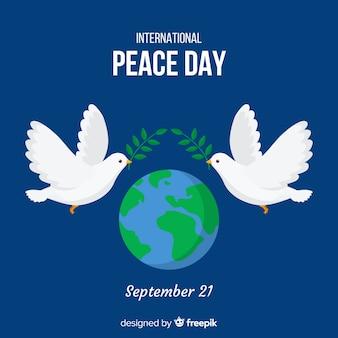 Friedenstageshintergrund mit tauben und welt