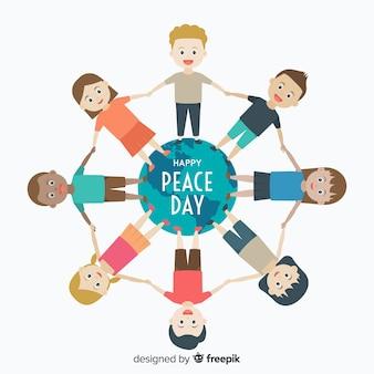 Friedenstageszusammensetzung mit dem kinderhändchenhalten auf der ganzen welt