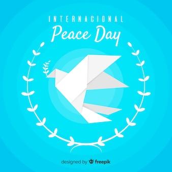 Friedenstaghintergrund mit origamitaube