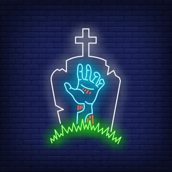 Friedhof mit grabstein- und zombiehandleuchtreklame
