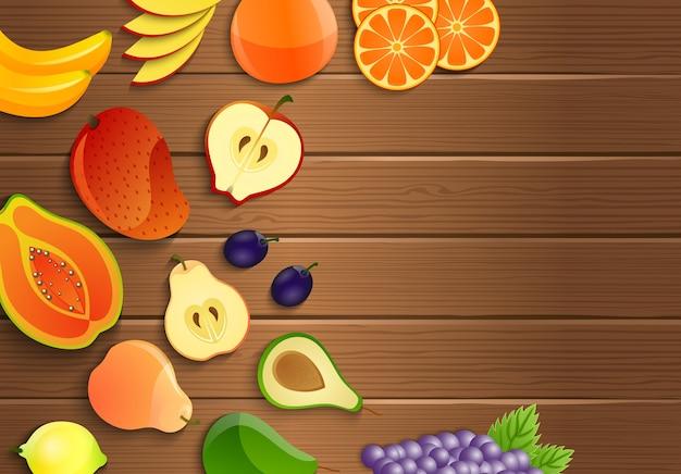 Frische früchte auf einem braunen hölzernen hintergrund