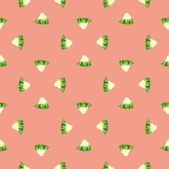 Friseesalat des nahtlosen musters auf pastellrosahintergrund. minimalistisches ornament mit salat. geometrische pflanzenvorlage für stoff. design-vektor-illustration.