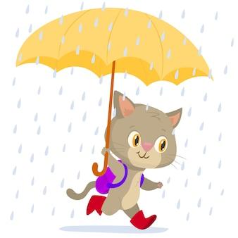 Fröhliche laufende katze mit einem regenschirm