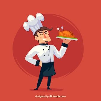 Fröhlicher chef hält ein gekochtes huhn