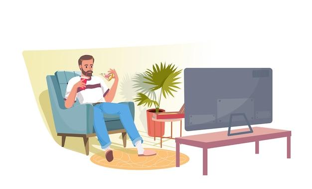 Fröhlicher, entspannter junger bärtiger mann, der im sessel sitzt, fernsieht und pizza isst