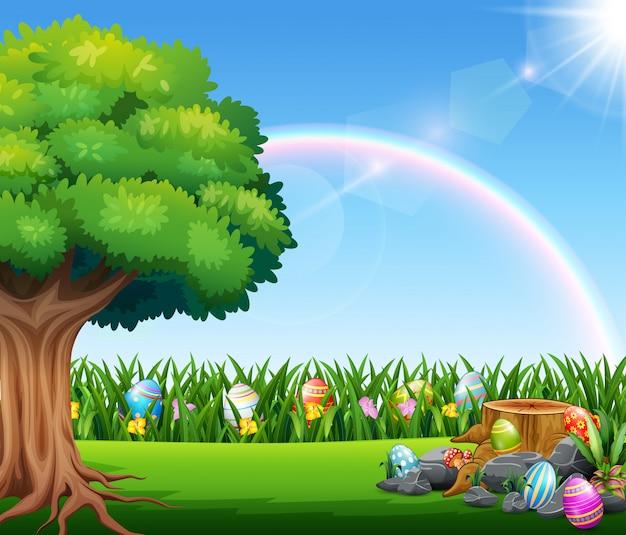Fröhlicher ostern-naturhintergrund mit regenbogen