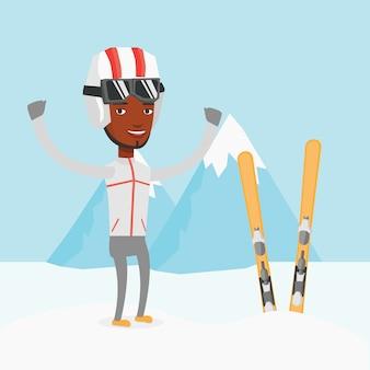 Fröhlicher skifahrer, der mit erhobenen händen steht.