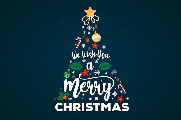 Fröhlicher weihnachtsbaum mit beschriftungsdekoration