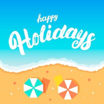 Frohe feiertage handgeschriebene beschriftung auf strandhintergrund.