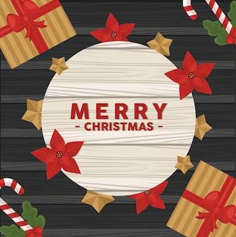 Frohe frohe weihnachten-beschriftungskarte mit blumen und geschenken im hölzernen hintergrund