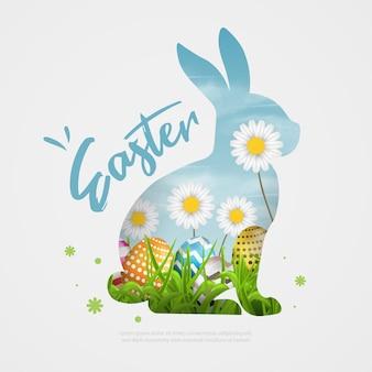 Frohe ostern-grußkarte. kaninchen- oder hasenform mit bunten eiern, realistischen blumen und himmel nach innen.