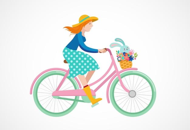 Frohe osternillustration mit mädchen, das ein fahrrad mit einem hasen innerhalb des korbs reitet