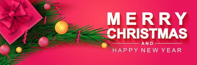 Frohe weihnachten 2022 und ein glückliches neues jahr banner weihnachtsfeiertagsplakat geschenkbox tannenzweige