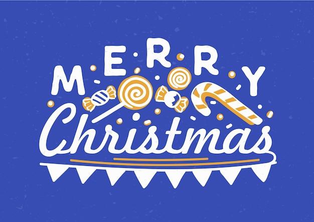 Frohe weihnachten geschrieben mit eleganter kursiver kalligraphischer schrift mit flaggengirlande, bonbons und lutschern