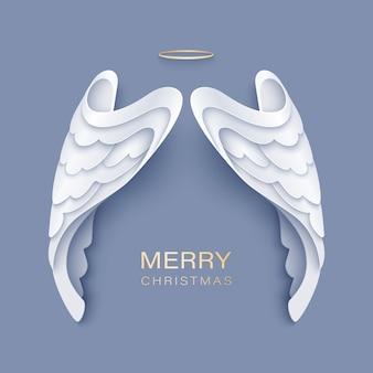 Frohe weihnachten gruß mit weißen engelsflügeln und goldenem nimbus Premium Vektoren