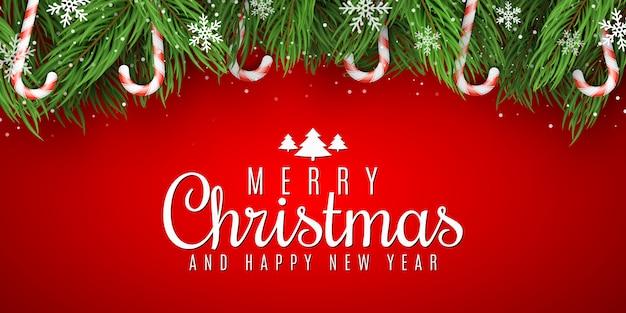 Frohe weihnachten gruß. tannenbaum mit hängenden lutschern. stilvoller schriftzug. fallende schneeflocken.