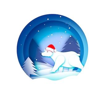 Frohe weihnachten grußkarte mit eisbär und schöner winterlandschaft. ursus maritimus. netter eisbär, der weihnachtsmannhut im papierschnittstil trägt. frohes neues jahr. blau.