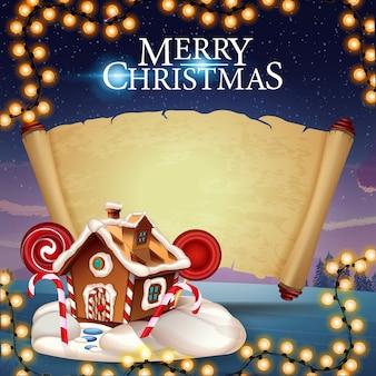 Frohe weihnachten, grußkarte mit weihnachtslebkuchenhaus und alter pergamentrolle